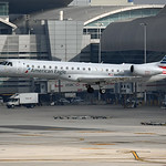 Date: 2/9/17 - Location: KMIA Dep/Arv/Enr: Arv - RW/Taxi/Ramp: RW27 Manufacturer: Embrarer Model:  ERJ145LR - Reg/Nmb: N677AE C/N:  14500810 Misc: Operated by Envoy